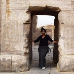 Travel Blogger standing by Kom Ombo. In front of the Temple of Sobek.