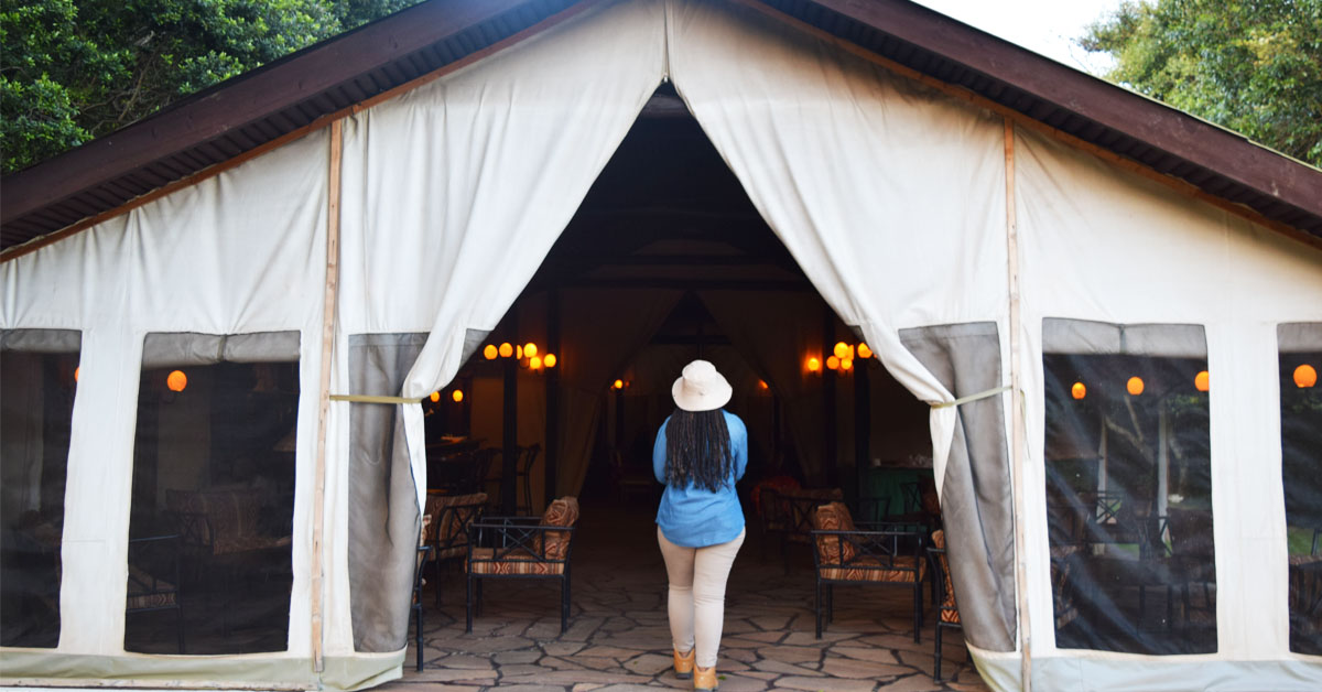 Woman walking into at the Sekenani Tented Camp in Kenya