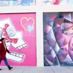 Lenzee walking in the Tulsa, Oklahoma Art District by street murals