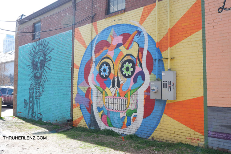 Mural of colorful skeleton with yellow, orange, blue and red designs