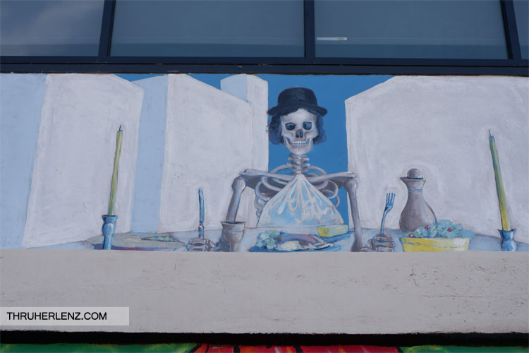 Last supper skeleton with a hat on in Tulsa