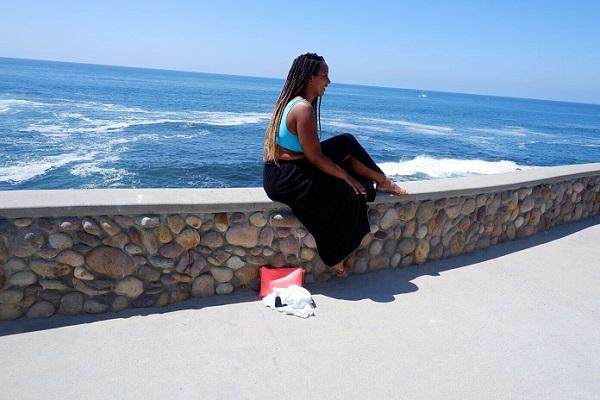 Sitting on the edge in San Diego La Jolla Cove Beach