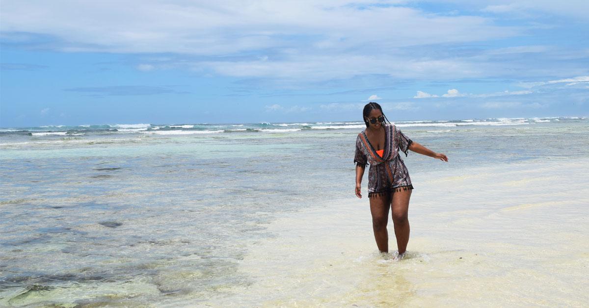 Woman standing in Indian Ocean on Diani Beach Kenya