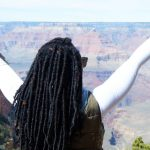 woman with hands up at Grand Canyon National Park