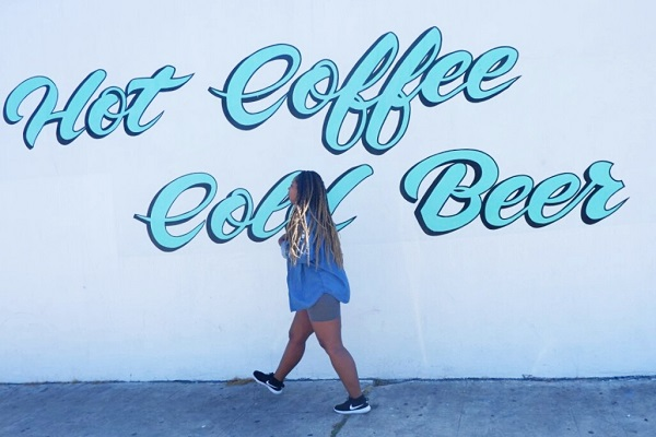 woman and the hot coffee cold beer sign in North Park California