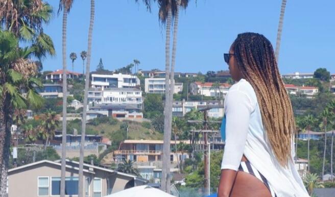 Woman overlooking the homes at La Jolla Beach California