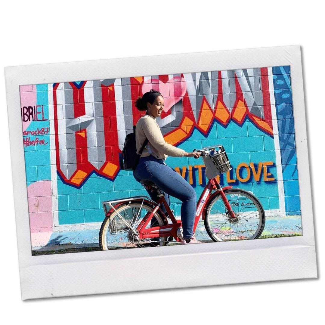 Black woman riding bike in Houston, Texas