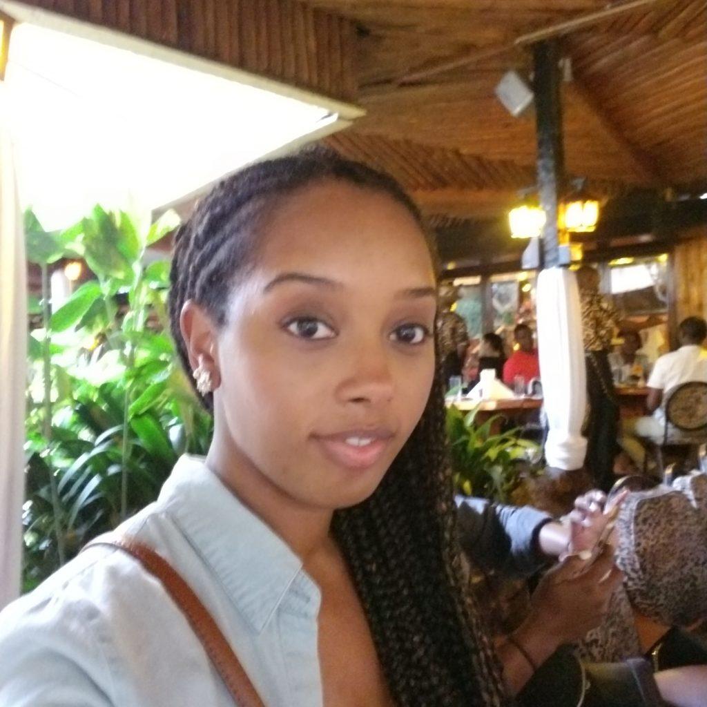 Black woman dining at Carnivore restaurant in Nairobi, Kenya, Africa