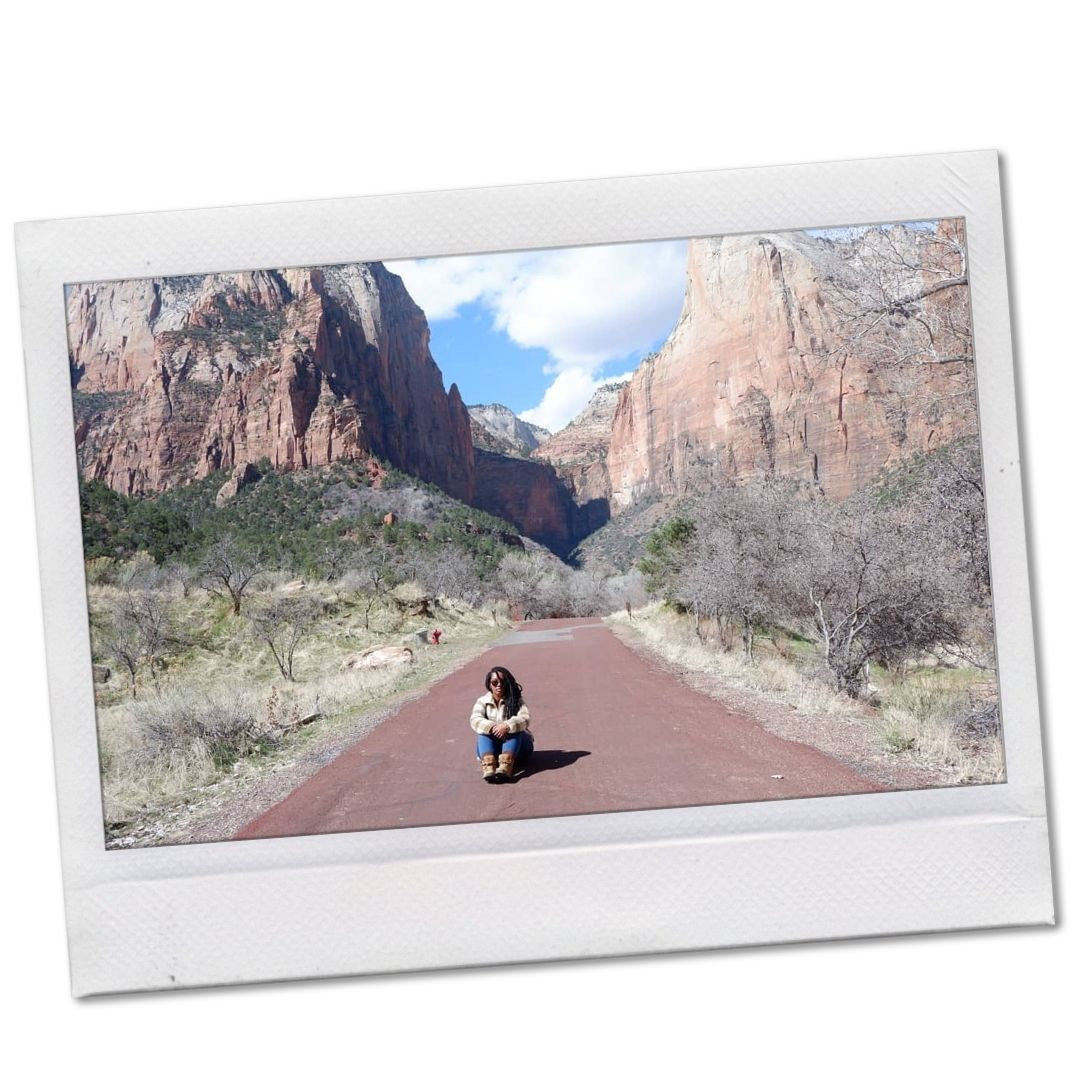 Black woman sitting on trail at Utah Zion National Park