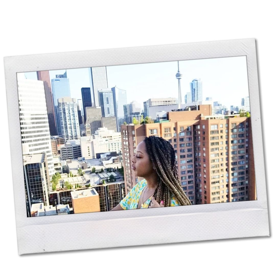 Black woman on rooftop in Toronto, Canada